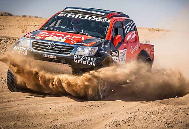DEVIL IN THE DUST: One of the Toyota SA Hilux rally bakkies at speed on the 2015 Morocco rallly. Image courtesy Toyota SA