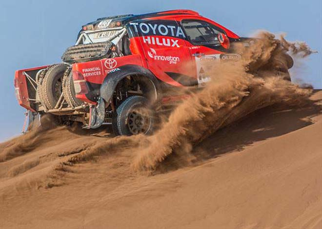 DUST BUSTER: South Africa's Leeroy Poulter and Rob Howie blast their Toyota Hilux through the crest of dune on Day 3 of the 2015 Morocco Rally. Image courtesy Toyota SA