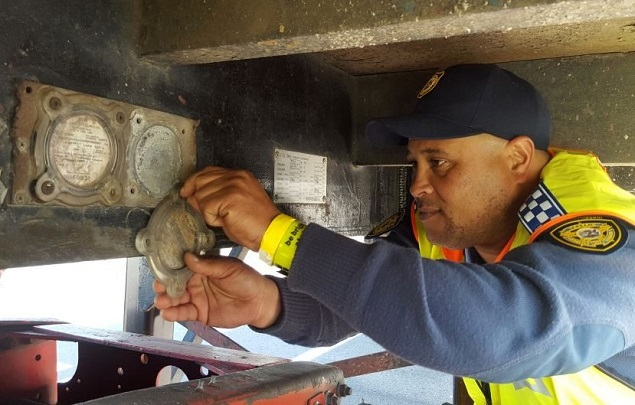 OFF COMES THE ROAD LICENCE: This truck won't be back on the road until al its faults are corrected. And, The Corner hopes, its owner severely puniched. Image: FleetWatch