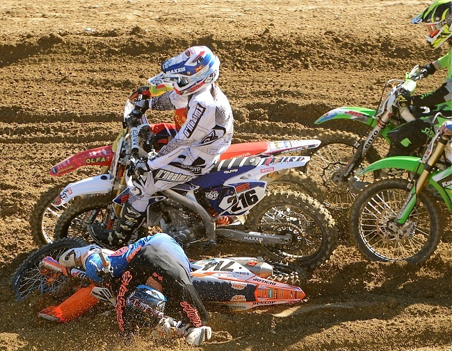 BOLD CAPS: Tim Sharp (714) got the hole shot for the first moto of the Over-40 Pro class but lost the front end at the bottom of Shoei Hill fell, and broke a leg - look closely at the photo. SA's Ryan Hunt is on the outside No. 215). Image: Supplied