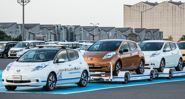 AUTONOMOUS TOWER OF STRENGTH AT WORK: One of the Nissan Leaf autonomous electric cars hooked to trollies being moved around a plant in Japan. Image: Nissan Japan