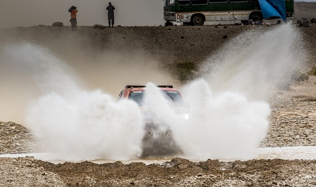 THERE'S A HILUX IN THERE: SA's Giniel de Villiers and Dirk von Zitzewitz take a bath on Stage 8 of the 2017 Dakar Rally. Image: Toyota SA