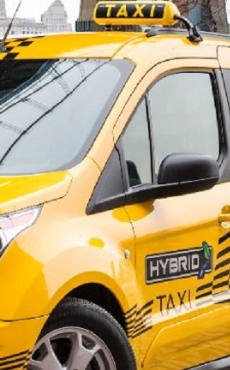 ELECTRIC TRANSIT TAXI: Just one of many hybrid and battery vehicles planned by Ford. Image: Ford / Quickpic