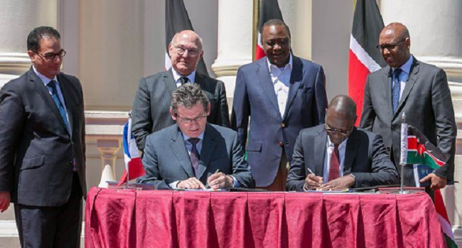 DONE DEAL: The Kenyan president and representatives of Peugeot PSA at sign up. Imange: Peugeot