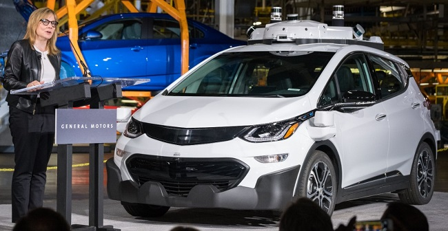 BARRA WHEELS OUT NEW SELF-DRIVERS: General Motors' chairman and CEO Mary Barra speaking in Michigan to announce that the automaker has completed production of 130 Chevrolet Bolt EV test vehicles equipped with self-driving technology. Image: GM / Steve Fecht