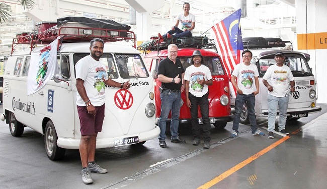 ACROSS ASIA TO VW PLANT: Welcome to Germany! The five intrepid Bulli pilots who drove from Malaysia parked outside the Hannover, Germany plant where their Bulli buses were probably assembled Image: VW / Newspress