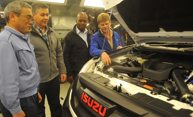 TOP GUYS, ON LINE: On the production line are (from left) manufacturing and engineering executive Masakiyo Arai, plant assistant manager Johan Vermeulen, production manager Brian Nyoka and general assembly area manager Bentley Hiscock. They're looking at a new Isuzu KB X-Rider. Image: Isuzu SA / Quickpic