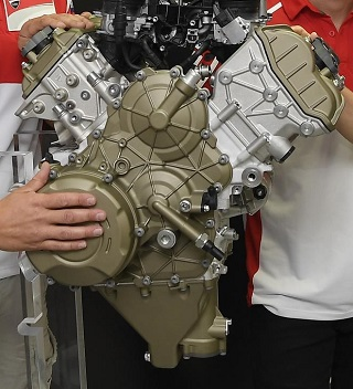 """NEW DESMOSEDICI V4: Unveiling the Desmosedici Stradale V4 engine in Bologna, Italy, were (from left) Ducati's CEO Claudio Domenicali and racers Michele Pirro, Andrea Dovizioso and Jorge Lorenzo. Image: Ducati   BOLOGNA, Italy - Ducati has given a preview of a new four-cylinder Desmosedici V4 engine designed, the prestige bikemaker says, """"to power the Ducati supersport models of tomorrow"""".  Transferring the technology of its most cutting-edge engine from racetrack to road, Ducati added, would give customers access to performance honed by years of MotoGP experience.  """"The Desmosedici Stradale,"""" Ducati says, """"will become yet another history-making Ducati milestone - the first time the Bologna-based company has put a four-cylinder engine in a production motorcycle.""""  The """"first look"""" was in Misano during the San Marino and Rimini Riviera GP, Round 13 of the 2017 MotoGP championship - regarded as a natural setting for the presentation because MotoGP is the proving ground from which the new engine drew its technology.  Claudio Domenicali, Ducati's CEO, told Carman's Corner in a media communication: """"It's with undiluted pride that we unveil this technological gem, the start of a chapter which will underline our vitality and commitment to investinbg in new products.""""  It also, he added, highlighted the close collaboration between Ducati Corse and the factory bike development team; a demonstration of how much racing can be involved in developing technology for production bikes.  The official introduction of the engine will be in the new Panigale V4 on the evening of November 5 2017 at the Misano Circuit in Rimini, Italy.  Some detail about the engine...  To maximise mid-range torque - """"essential for a satisfying road experience"""", Ducati says - and ensure punchy torque and power at lower revs it has a slightly larger displacement than its MotoGP counterpart (1103cc). Power output exceeds 155kW at 13 000rpm,  torque exceeds 120Nm from 8750 to 12 250 rpm.  An R version of less """