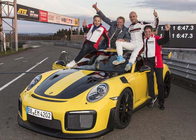 TEAM HONOURS: The Porsche drivers and crew after setting lap records at the Nuerburgring. Image: Porsche / Newspress