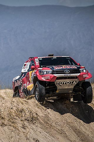 BLUE-SKY RACING: One of the South African Toyota entries crests yet another dune. Image: Toyota SA