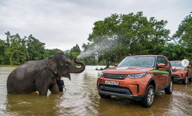 HEADING AROUND THE WORLD: The Land Rover expedition on its way across a river in Thailand. Image: Land Rover
