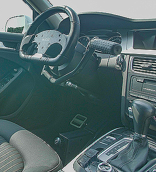 IN THE DRIVING SEAT: Conventional accelerator and brake have been removed from the driver's footwell and replaced by a set of bicycle-like pedals. Praking is achieved with the lever to the right of the steering-wheel. Image: Supplied