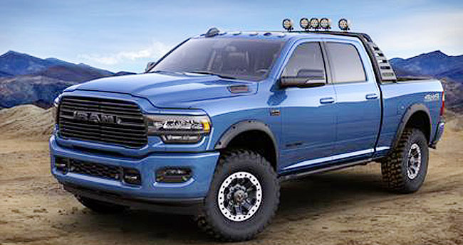 Jim Morrison (left), Head of Ram Brand, FCA North America, and John Fox, Head of Mopar Sales and Product Development – U.S., unveil a Mopar-modified version of the new 2019 Ram 2500 Heavy Duty truck at the Chicago Auto Show on February 8, 2019