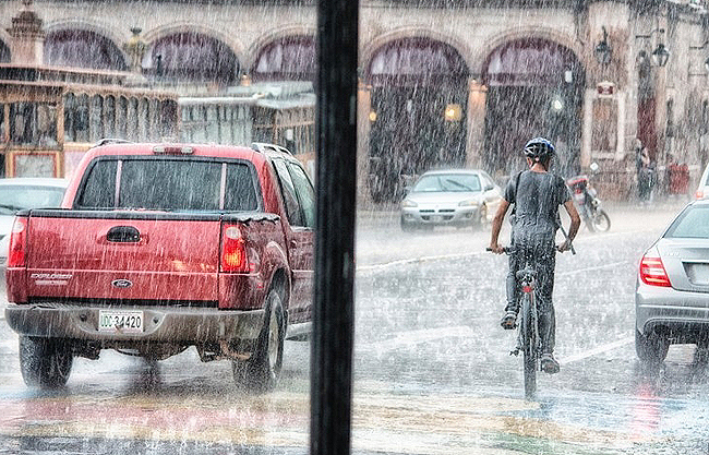 RIDING IN THE RAIN. Image: Supplied